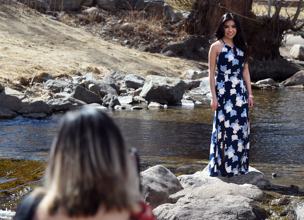 . Brisni Ruiz, bottom, and Abigail Alvarez, work on their senior photos in Boulder Creek. Several people were enjoying Boulder Creek near the Boulder Public Library on Friday. For more photos, go to dailycamera.com. Cliff Grassmick  Photographer  March 9, 2018