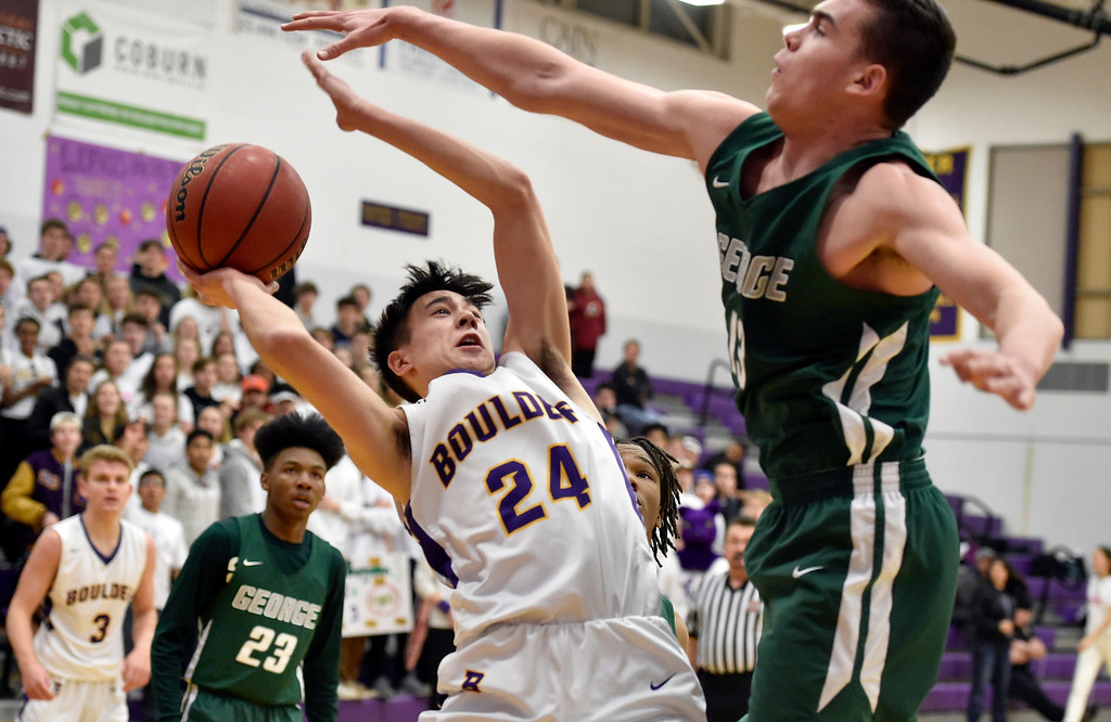 . BOULDER, CO - FEBRUARY 20, 2019: Boulder High School\'s Tyler Turner takes a shot under the arms of Blake Whitelaw during a first-round playoff game against George Washington High School on Wednesday in Boulder. More photos: BoCoPreps.com (Photo by Jeremy Papasso/Staff Photographer)