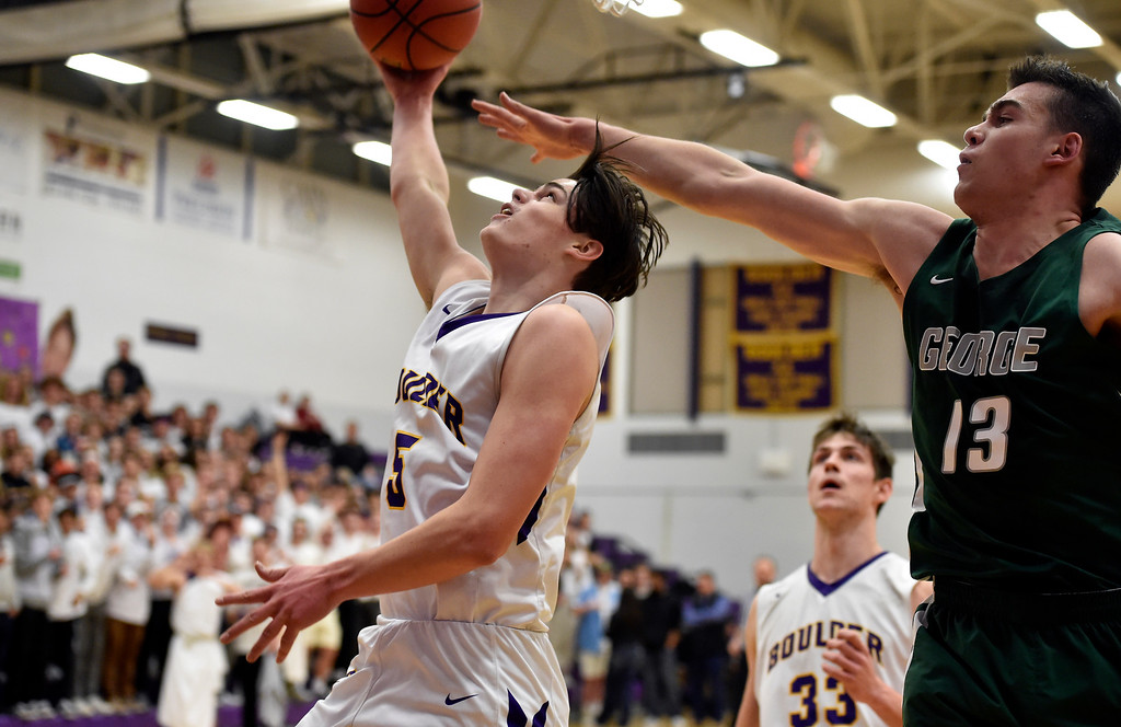 . BOULDER, CO - FEBRUARY 20, 2019: Boulder High School\'s Justin Bartsch goes for a layup under the arms of Blake Whitelaw during a first-round playoff game against George Washington High School on Wednesday in Boulder. More photos: BoCoPreps.com (Photo by Jeremy Papasso/Staff Photographer)