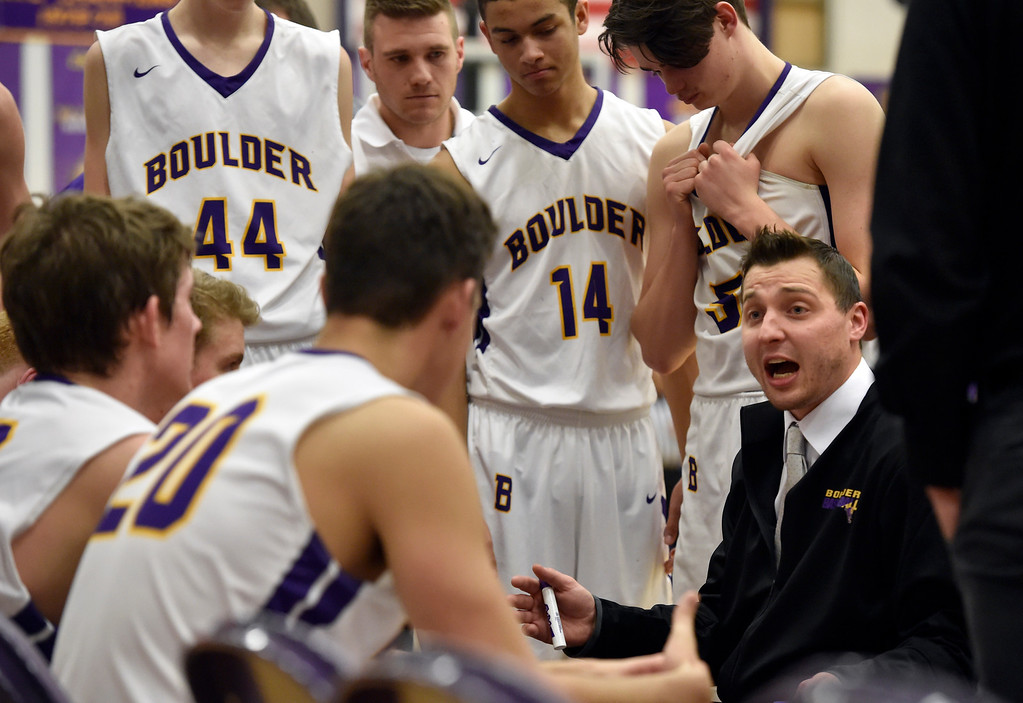 . BOULDER, CO - FEBRUARY 20, 2019: Boulder High School Head Coach Riley Grabau talks with his team during a first-round playoff game against George Washington High School on Wednesday in Boulder. More photos: BoCoPreps.com (Photo by Jeremy Papasso/Staff Photographer)