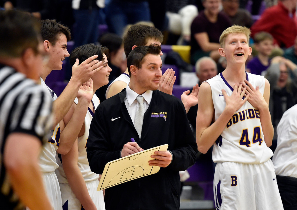 . BOULDER, CO - FEBRUARY 20, 2019: Boulder High School\'s Pete Boyle, at right, and Head Coach Riley Grabau react in the final seconds of the game during a first-round playoff game against George Washington High School on Wednesday in Boulder. Boulder won the game. More photos: BoCoPreps.com (Photo by Jeremy Papasso/Staff Photographer)