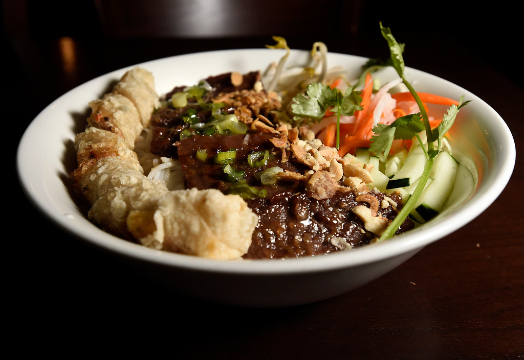 . Grilled beef and egg roll noodle bowl at Boulder Pho on Monday in Boulder. For more photos of the food at Boulder Pho go to dailycamera.com Jeremy Papasso Staff Photographer July, 31 2017