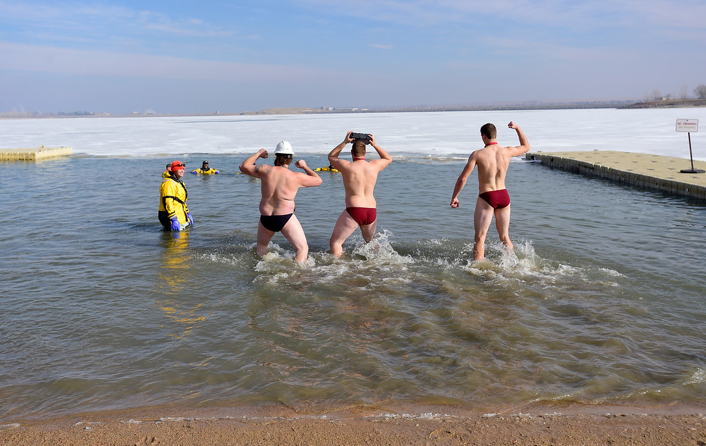 . A team dances their way into the water during the Boulder Polar Plunge, a benefit for the American Cancer Society, at Boulder Reservoir in Boulder, Colorado on Jan. 1, 2018. (Photo by Matthew Jonas/Times-Call)