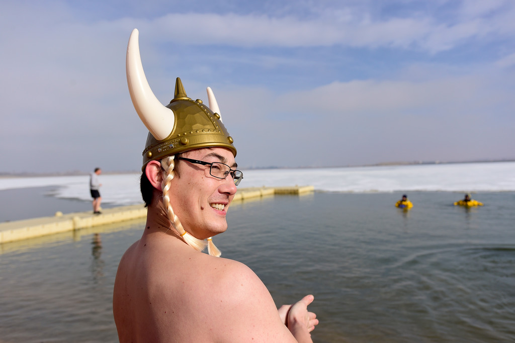 . Joshua Smith, of Frederick, waits for his turn to jump into Boulder Reservoir during the Boulder Polar Plunge, a benefit for the American Cancer Society, in Boulder, Colorado on Jan. 1, 2018. (Photo by Matthew Jonas/Times-Call)