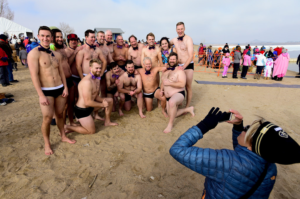 ". Team ""Ham Hock\"" gathers for a photo during the Boulder Polar Plunge, a benefit for the American Cancer Society, at Boulder Reservoir in Boulder, Colorado on Jan. 1, 2018. (Photo by Matthew Jonas/Times-Call)"