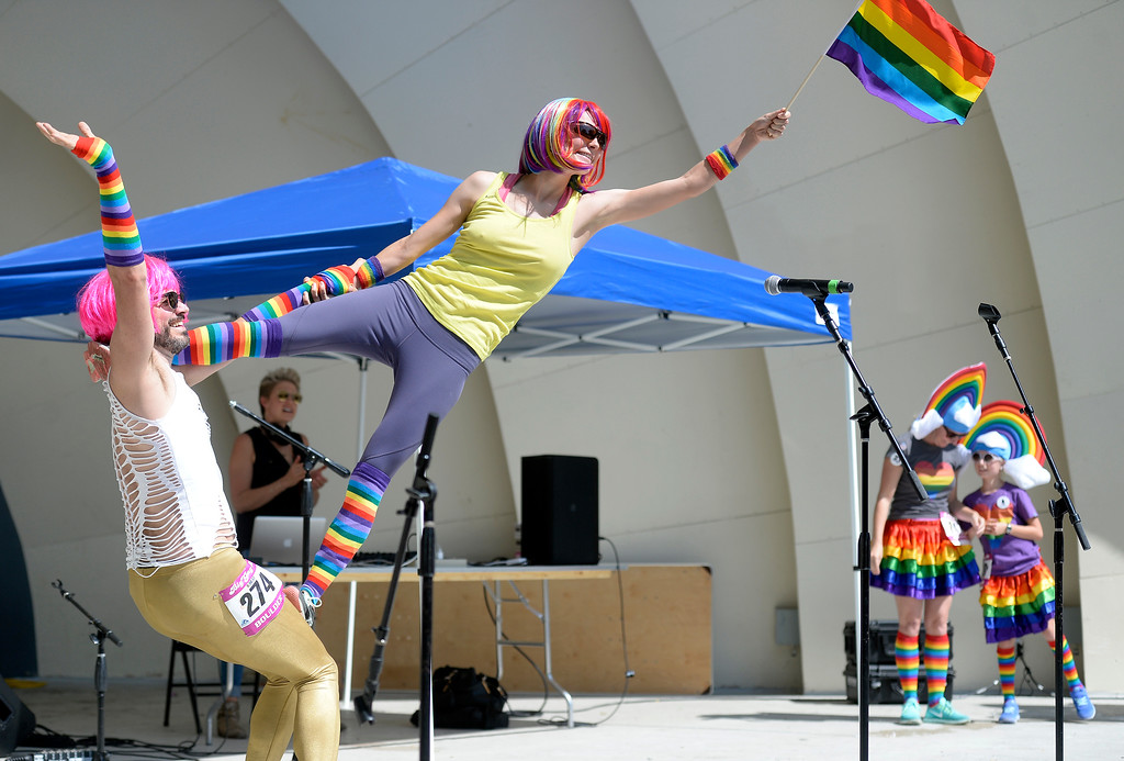 . Jeremy Simon, left, holds Hannah Lees for the Gay 5K costume contest during the Boulder Pridefest 2017 celebration on Sunday at Central Park in Boulder, Colo. For more photos of the Pridefest celebration go to dailycamera.com Jeremy Papasso/ Staff Photographer/ Sept. 10, 2017