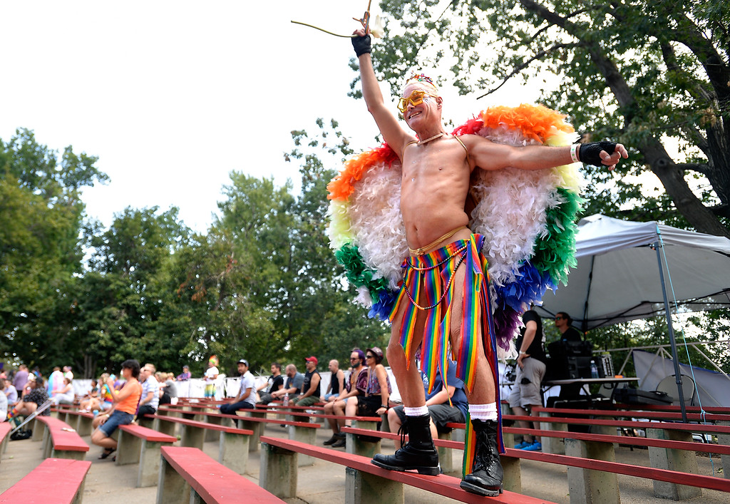 . Phillipe Johns dances while a band performs during the Boulder Pridefest 2017 celebration on Sunday at Central Park in Boulder, Colo. For more photos of the Pridefest celebration go to dailycamera.com Jeremy Papasso/ Staff Photographer/ Sept. 10, 2017