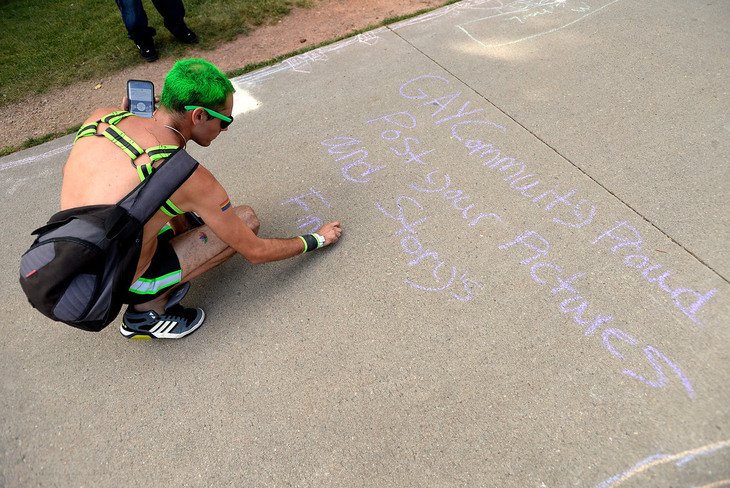 . David Star writes with chalk on the sidewalk during the Boulder Pridefest 2017 celebration on Sunday at Central Park in Boulder, Colo. For more photos of the Pridefest celebration go to dailycamera.com Jeremy Papasso/ Staff Photographer/ Sept. 10, 2017