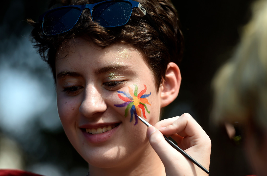 . Natasha, last name not given, smiles while getting facepaint applied by Boulder Preparatory volunteer Alex Cavalieri during the Boulder Pridefest 2017 celebration on Sunday at Central Park in Boulder, Colo. For more photos of the Pridefest celebration go to dailycamera.com Jeremy Papasso/ Staff Photographer/ Sept. 10, 2017