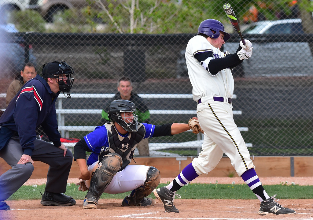 . Boulder High School\'s Jackson Dinkel hits a single against  Broomfield High during their game at Scott Carpenter Park on Thursday in Boulder. For more photos go to www.bocopreps.com Paul Aiken Staff Photographer April 20, 2017