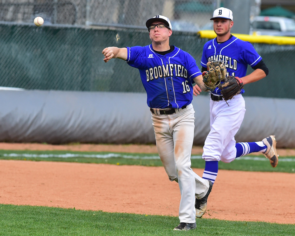 . Broomfield High\'s Tanner Garner makes a throw for a force out during their game at Scott Carpenter Park on Thursday in Boulder. For more photos go to www.bocopreps.com Paul Aiken Staff Photographer April 20, 2017