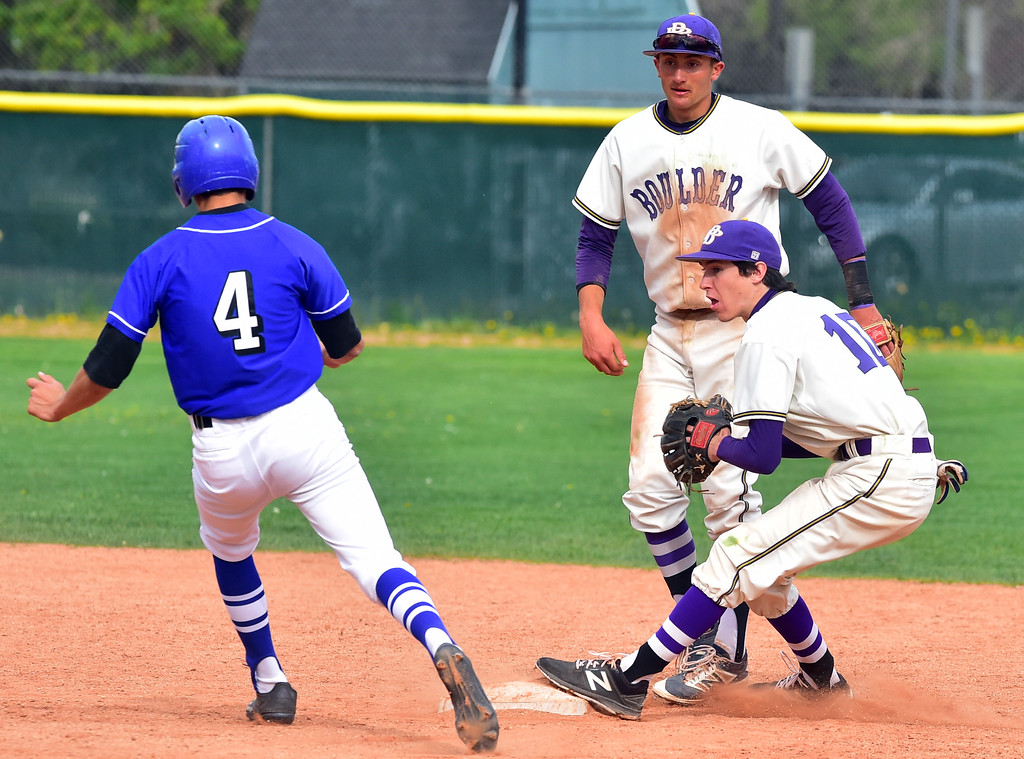 . Boulder High School\'s Brendan Van Haute makes a force out against Broomfield High\'s Mitch Morales during their game at Scott Carpenter Park on Thursday in Boulder. Morales had gone for a steal to second and the ball was hit directly at the base allowing Van Haute to get a double play For more photos go to www.bocopreps.com Paul Aiken Staff Photographer April 20, 2017
