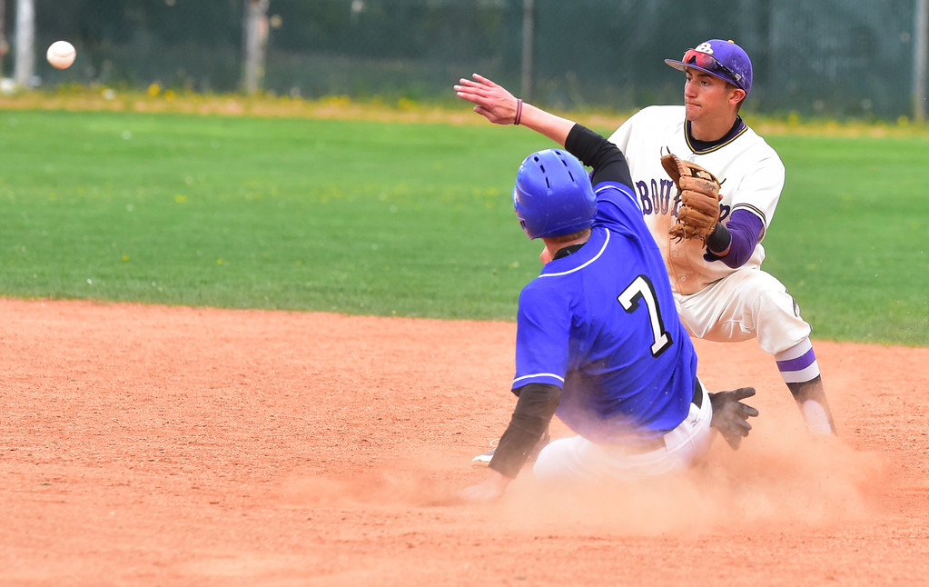 . Boulder High\'s Henry Ryan can\'t get Broomfield High\'s Josh Cox out stealing second during their game at Scott Carpenter Park on Thursday in Boulder. For more photos go to www.bocopreps.com Paul Aiken Staff Photographer April 20, 2017