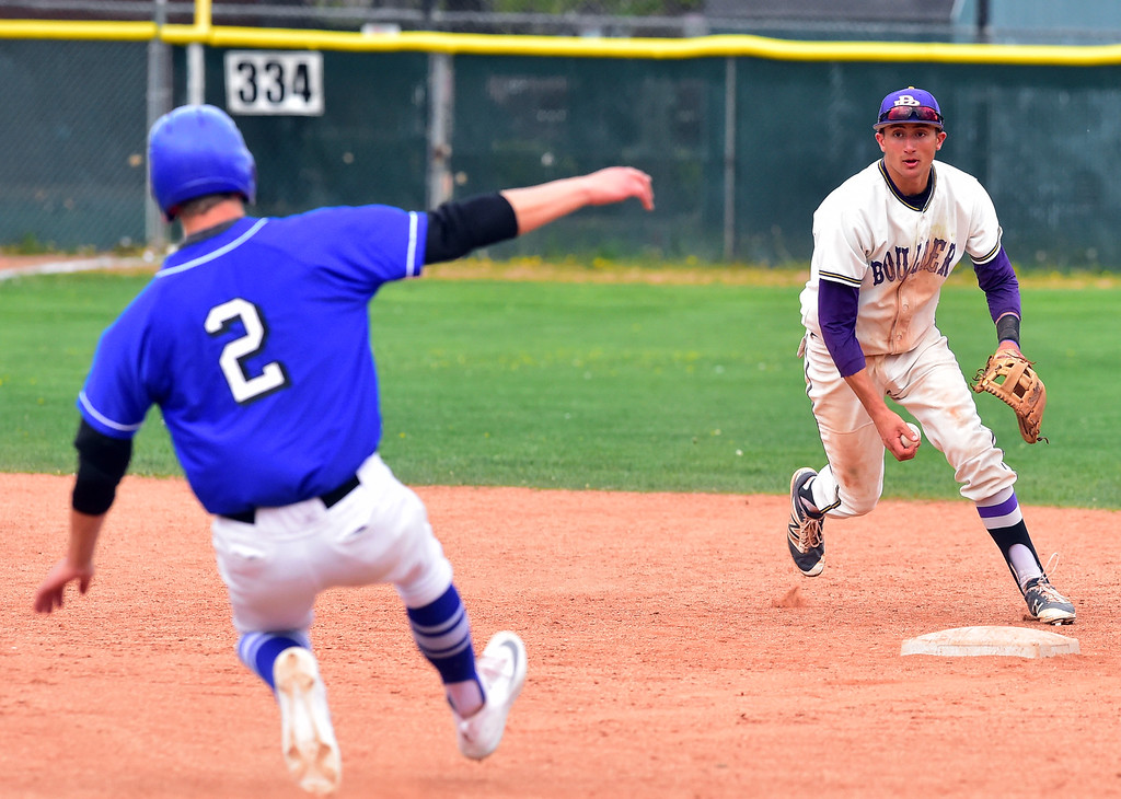 . Boulder High\'s Henry Ryan forces out Broomfield High\'s Blake Rohm but can\'t complete the double play during their game at Scott Carpenter Park on Thursday in Boulder. For more photos go to www.bocopreps.com Paul Aiken Staff Photographer April 20, 2017