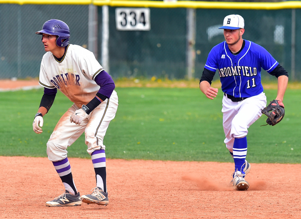 . Boulder High School\'s Henry Ryan leads off second as Broomfield High\'s James Notary sneaks up behind him during their game at Scott Carpenter Park on Thursday in Boulder. For more photos go to www.bocopreps.com Paul Aiken Staff Photographer April 20, 2017