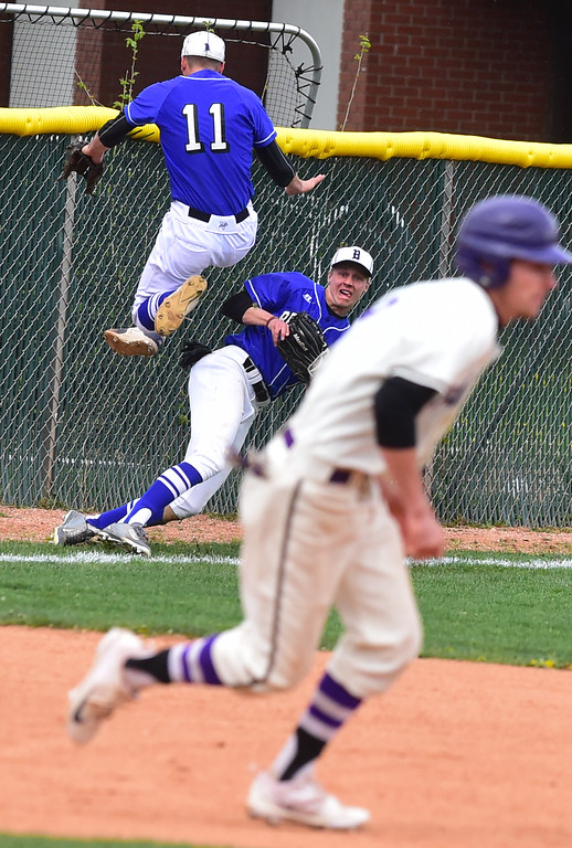 . Broomfield High\'s James Notary jumps over Josh Cox after Cox made a long run to grab a ball in foul territory during their game against Boulder High at Scott Carpenter Park on Thursday in Boulder. For more photos go to www.bocopreps.com Paul Aiken Staff Photographer April 20, 2017