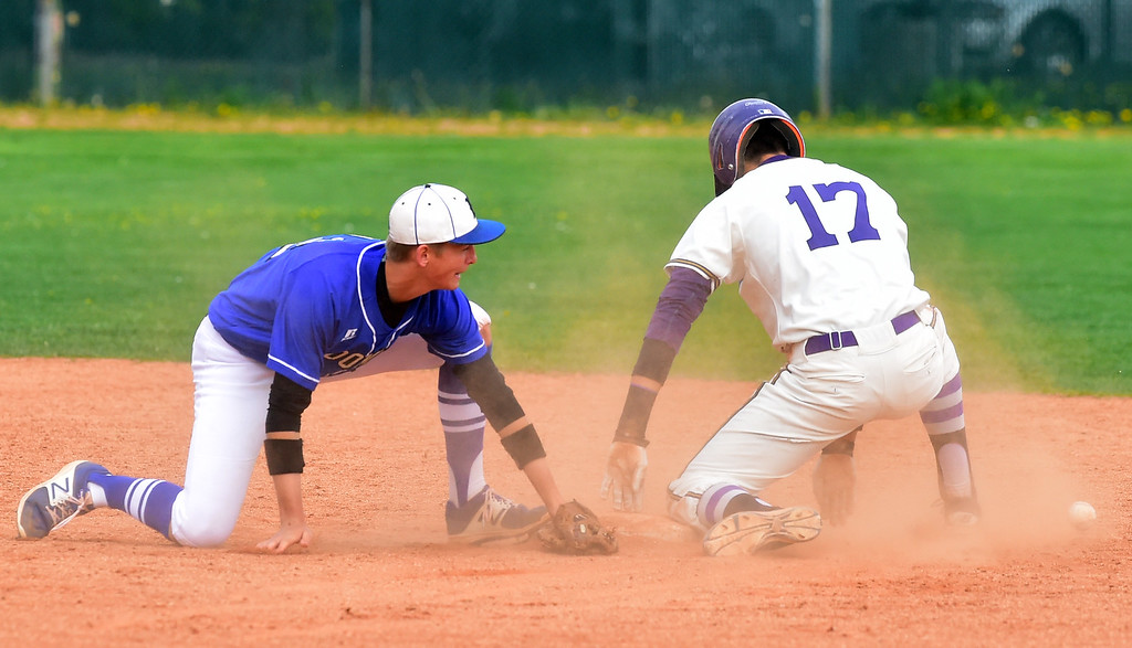 . Boulder High School\'s Henry Ryan steals second as Broomfield High\'s Tyler Conover can\'t handle the throw during their game at Scott Carpenter Park on Thursday in Boulder. For more photos go to www.bocopreps.com Paul Aiken Staff Photographer April 20, 2017