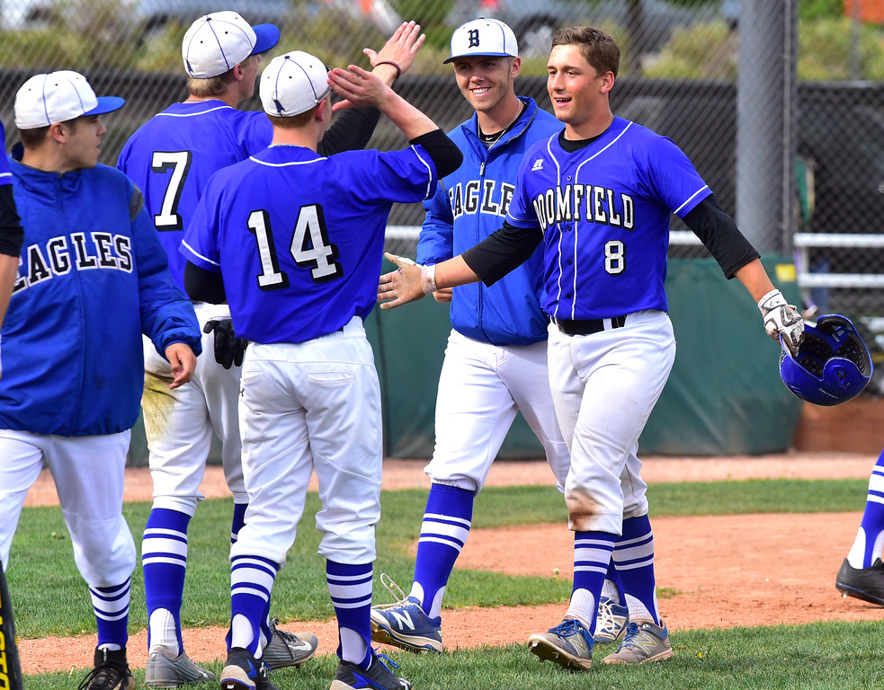 . Broomfield High\'s Mason Speirs gets congratulated by teammates after he hit a home run against Boulder High during their game at Scott Carpenter Park on Thursday in Boulder. For more photos go to www.bocopreps.com Paul Aiken Staff Photographer April 20, 2017