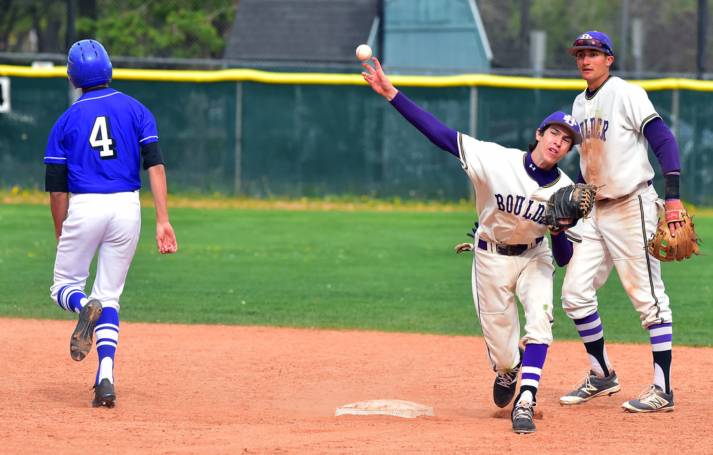 . Boulder High School\'s Brendan Van Haute makes a force out against Broomfield High\'s Mitch Morales and then completes a double play during their game at Scott Carpenter Park on Thursday in Boulder. Morales had gone for a steal to second and the ball was hit directly at the base allowing Van Haute to get a double play For more photos go to www.bocopreps.com Paul Aiken Staff Photographer April 20, 2017