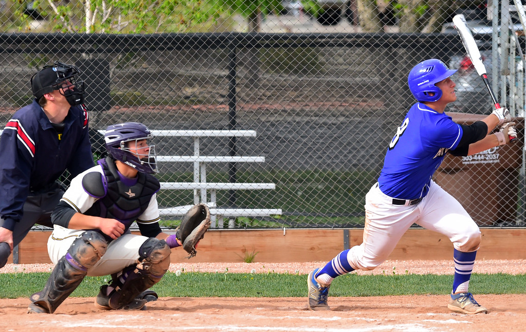 . Broomfield High\'s Mason Speirs hits a home run against Boulder High during their game at Scott Carpenter Park on Thursday in Boulder. For more photos go to www.bocopreps.com Paul Aiken Staff Photographer April 20, 2017
