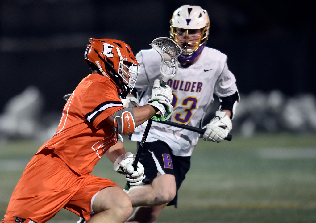. BOULDER, CO - MARCH 12, 2019: Erie High School\'s Tyler Gardner moves the ball past Henry Dyer during a lacrosse game against Boulder on Wednesday at Recht Field in Boulder More photos: BoCoPreps.com  (Photo by Jeremy Papasso/Staff Photographer)