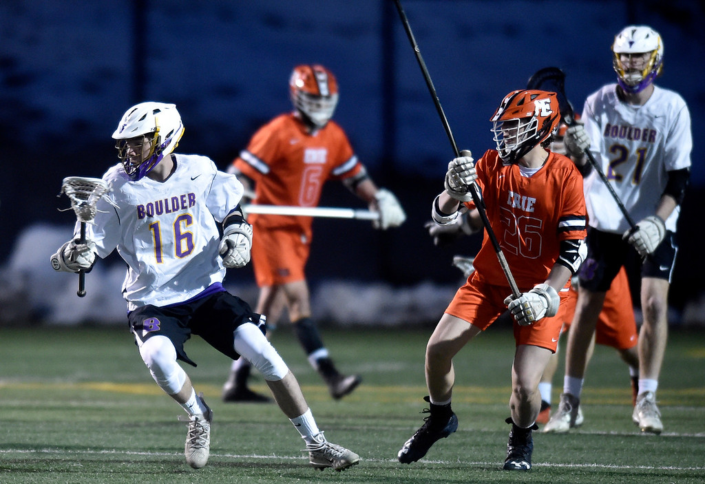 . BOULDER, CO - MARCH 12, 2019: Boulder High School\'s Noah Harding moves the ball upfield during a lacrosse game against Erie on Wednesday at Recht Field in Boulder More photos: BoCoPreps.com  (Photo by Jeremy Papasso/Staff Photographer)