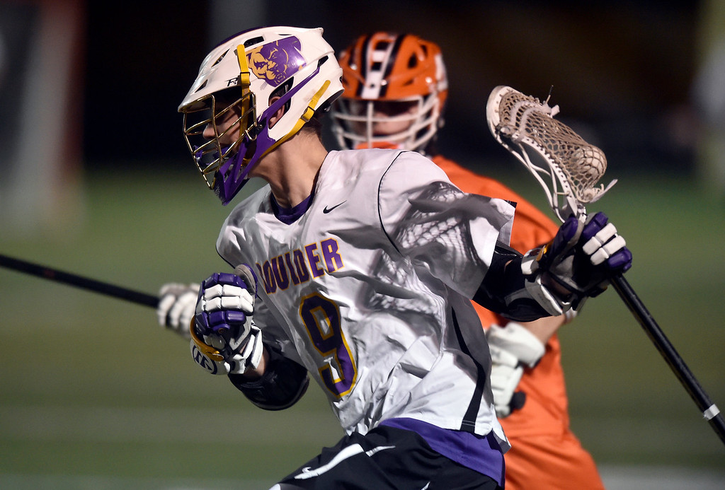 . BOULDER, CO - MARCH 12, 2019: Boulder High School\'s Griffin Eiss moves the ball towards the goal during a lacrosse game against Erie on Wednesday at Recht Field in Boulder More photos: BoCoPreps.com  (Photo by Jeremy Papasso/Staff Photographer)