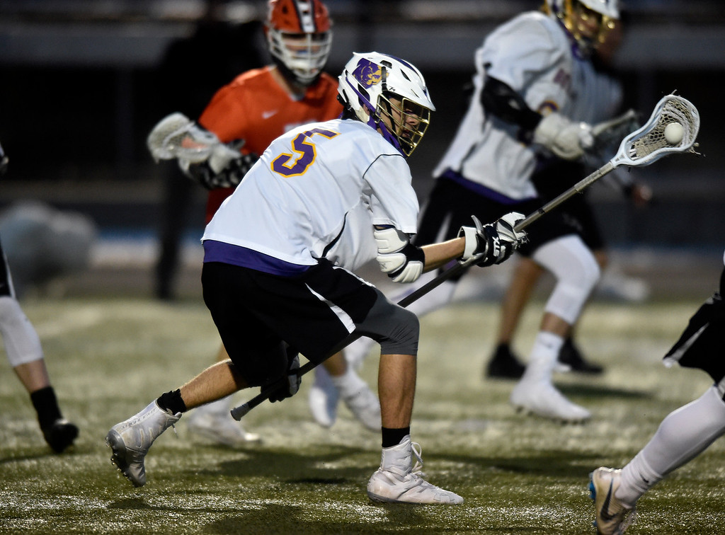. BOULDER, CO - MARCH 12, 2019: Boulder High School\'s Pete Duffield snags a loose ball during a lacrosse game against Erie on Wednesday at Recht Field in Boulder More photos: BoCoPreps.com  (Photo by Jeremy Papasso/Staff Photographer)