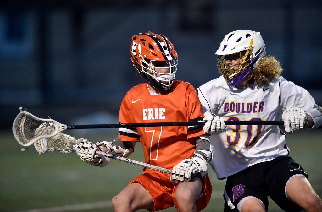 . BOULDER, CO - MARCH 12, 2019: Erie High School\'s Adam Bristow moves the ball past Connor McCullick during a lacrosse game against Boulder on Wednesday at Recht Field in Boulder More photos: BoCoPreps.com  (Photo by Jeremy Papasso/Staff Photographer)