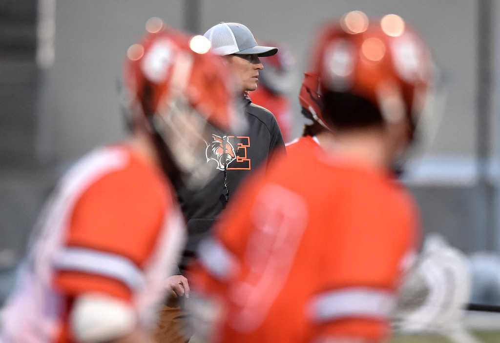 . BOULDER, CO - MARCH 12, 2019: Erie High School Head Coach Nick Mandia watches his team warm up before a lacrosse game against Boulder on Wednesday at Recht Field in Boulder More photos: BoCoPreps.com  (Photo by Jeremy Papasso/Staff Photographer)