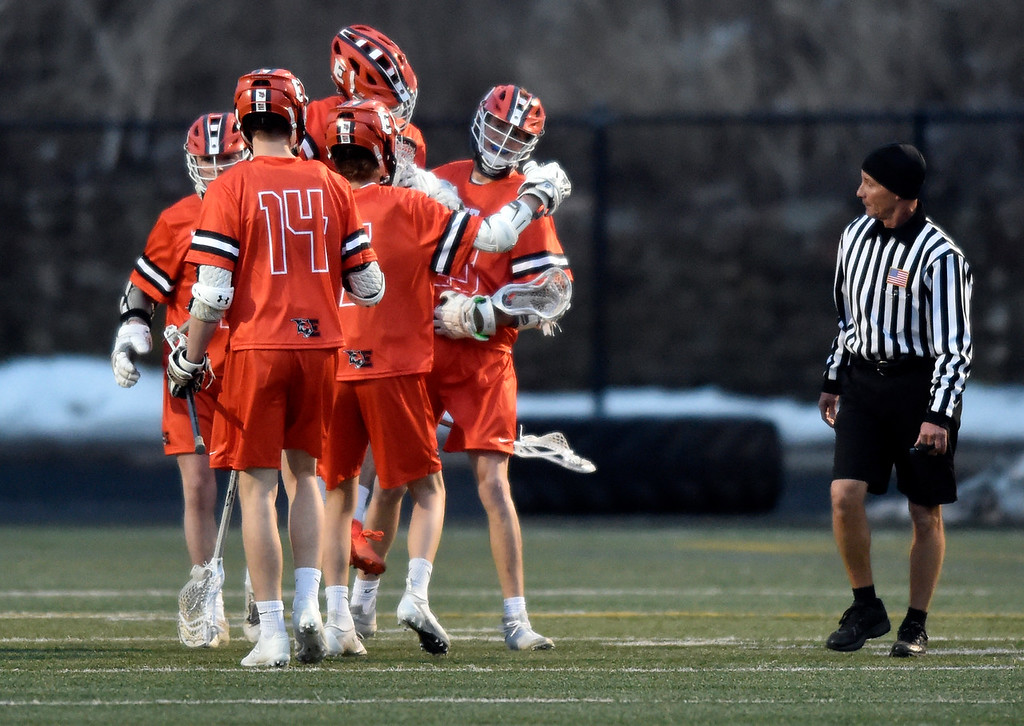 . BOULDER, CO - MARCH 12, 2019: Erie High School\'s Jackson Keener, at right, is congratulated on a goal by teammates during a lacrosse game against Boulder on Wednesday at Recht Field in Boulder More photos: BoCoPreps.com  (Photo by Jeremy Papasso/Staff Photographer)