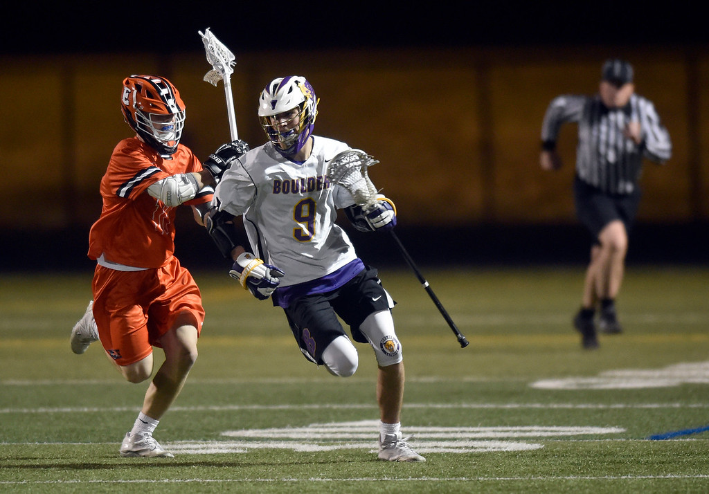 . BOULDER, CO - MARCH 12, 2019: Boulder High School\'s Griffin Eiss moves the ball upfield during a lacrosse game against Erie on Wednesday at Recht Field in Boulder More photos: BoCoPreps.com  (Photo by Jeremy Papasso/Staff Photographer)