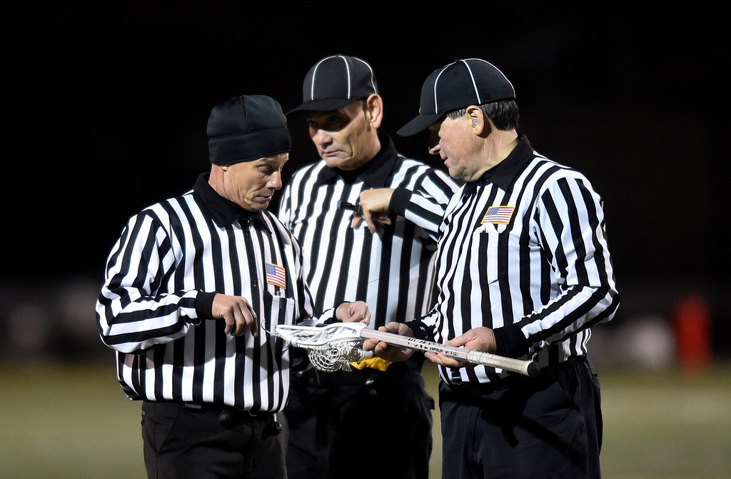 . BOULDER, CO - MARCH 12, 2019: Referees measure a lacrosse stick during a lacrosse game between Erie and Boulder on Wednesday at Recht Field in Boulder More photos: BoCoPreps.com  (Photo by Jeremy Papasso/Staff Photographer)