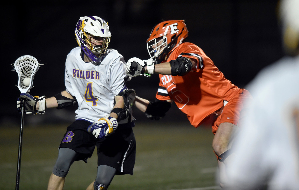 . BOULDER, CO - MARCH 12, 2019: Boulder High School\'s James Spillman moves the ball past Sage Gardner during a lacrosse game against Erie on Wednesday at Recht Field in Boulder More photos: BoCoPreps.com  (Photo by Jeremy Papasso/Staff Photographer)