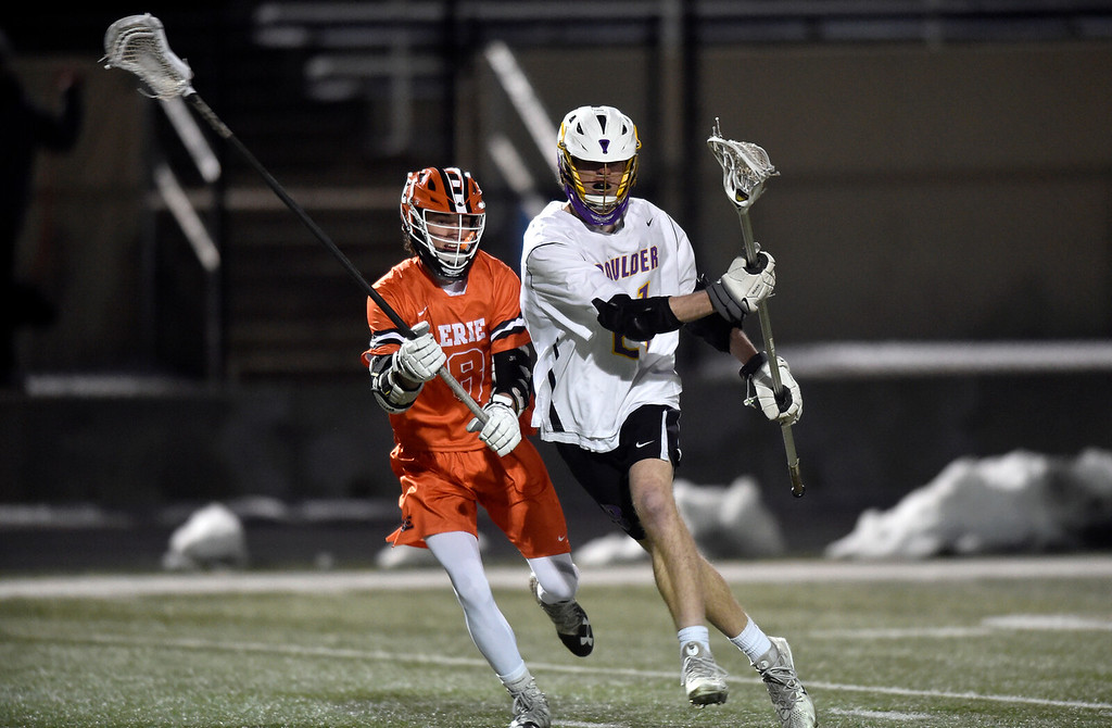 . BOULDER, CO - MARCH 12, 2019: Boulder High School\'s Leo Barringer moves the ball upfield during a lacrosse game against Erie on Wednesday at Recht Field in Boulder More photos: BoCoPreps.com  (Photo by Jeremy Papasso/Staff Photographer)