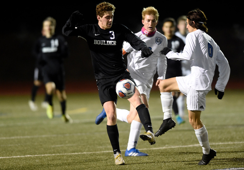 . PARKER, CO - NOVEMBER 7, 2018: Boulder High School\'s Jesse Bacardi fights for the ball with Jackson Tomiyama during a CHSAA 5A semi-final playoff game against Grandview High School on Wednesday at Echo Park Stadium in Parker. Boulder lost the game 2-0. More photos: BoCoPreps.com