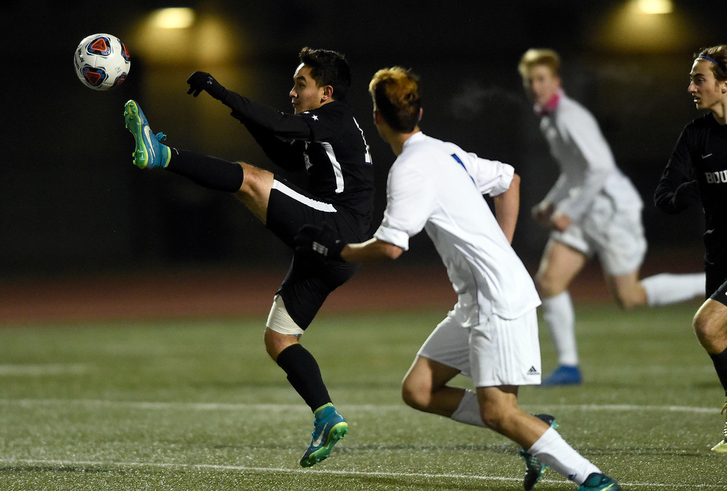 . PARKER, CO - NOVEMBER 7, 2018: Boulder High School\'s Omar Castruita tries to stop a ball during a CHSAA 5A semi-final playoff game against Grandview High School on Wednesday at Echo Park Stadium in Parker. Boulder lost the game 2-0. More photos: BoCoPreps.com