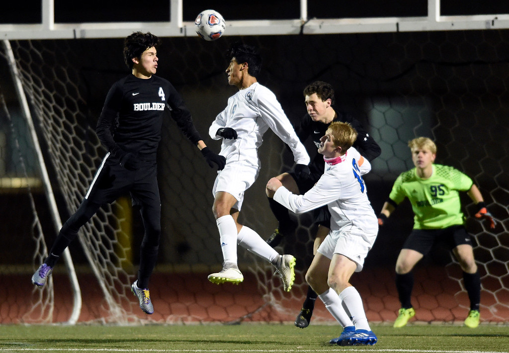 . PARKER, CO - NOVEMBER 7, 2018: Boulder High School\'s Ian McDiarmid-Sterling, No. 4, watches as Jaimie Luna heads a corner kick for a goal during a CHSAA 5A semi-final playoff game against Grandview High School on Wednesday at Echo Park Stadium in Parker. Boulder lost the game 2-0. More photos: BoCoPreps.com