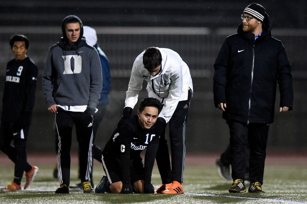 . PARKER, CO - NOVEMBER 7, 2018: Boulder High School\'s Omar Castruita is consoled by a teammate after losing a CHSAA 5A semi-final playoff game against Grandview High School on Wednesday at Echo Park Stadium in Parker. Boulder lost the game 2-0. More photos: BoCoPreps.com