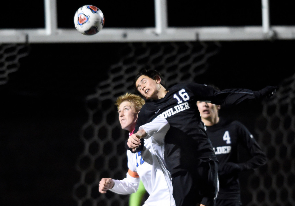 . PARKER, CO - NOVEMBER 7, 2018: Boulder High School\'s Kenneth Jew heads the ball over Peter Goldy during a CHSAA 5A semi-final playoff game against Grandview High School on Wednesday at Echo Park Stadium in Parker. Boulder lost the game 2-0. More photos: BoCoPreps.com