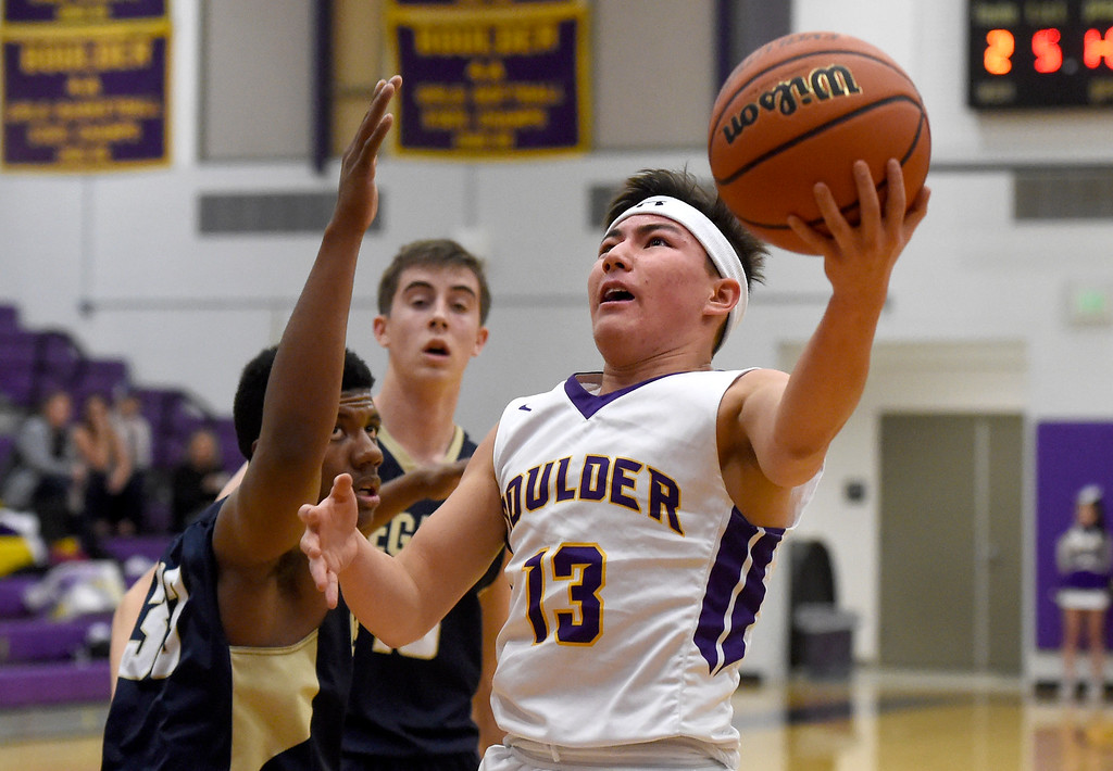 . Boulder High School\'s Davis Kang goes for a layup during a game against Legacy in a basketball game on Tuesday in Boulder. More photos: BoCoPreps.com Jeremy Papasso/ Staff Photographer 01/09/2018