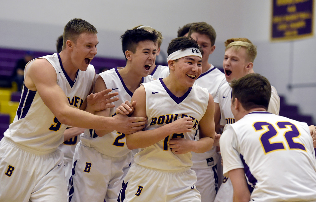 . BEST 1. Boulder High School\'s Davis Kang, at center, celebrates his game winning shot with teammates after defeating Legacy in a basketball game on Tuesday in Boulder. More photos: BoCoPreps.com Jeremy Papasso/ Staff Photographer 01/09/2018