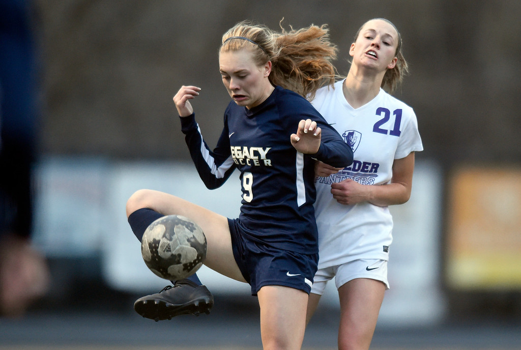 . Legacy High School\'s Nora Spuler stops a ball in front of Hannah Dudiak during a game against Boulder on Thursday at Recht Field in Boulder. More photo: BoCoPreps.com Jeremy Papasso/ Staff Photographer 04/12/2018