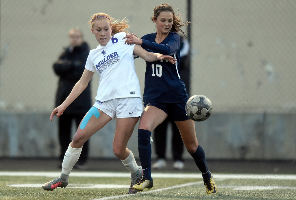 . Legacy High School\'s Gracie Armstrong fights for the ball with Alia Mentzell during a game against Boulder on Thursday at Recht Field in Boulder. More photo: BoCoPreps.com Jeremy Papasso/ Staff Photographer 04/12/2018