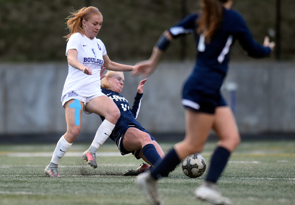 . Legacy High School\'s Randi Heaton slides for the ball past Alia Mentzell during a game against Boulder on Thursday at Recht Field in Boulder. More photo: BoCoPreps.com Jeremy Papasso/ Staff Photographer 04/12/2018