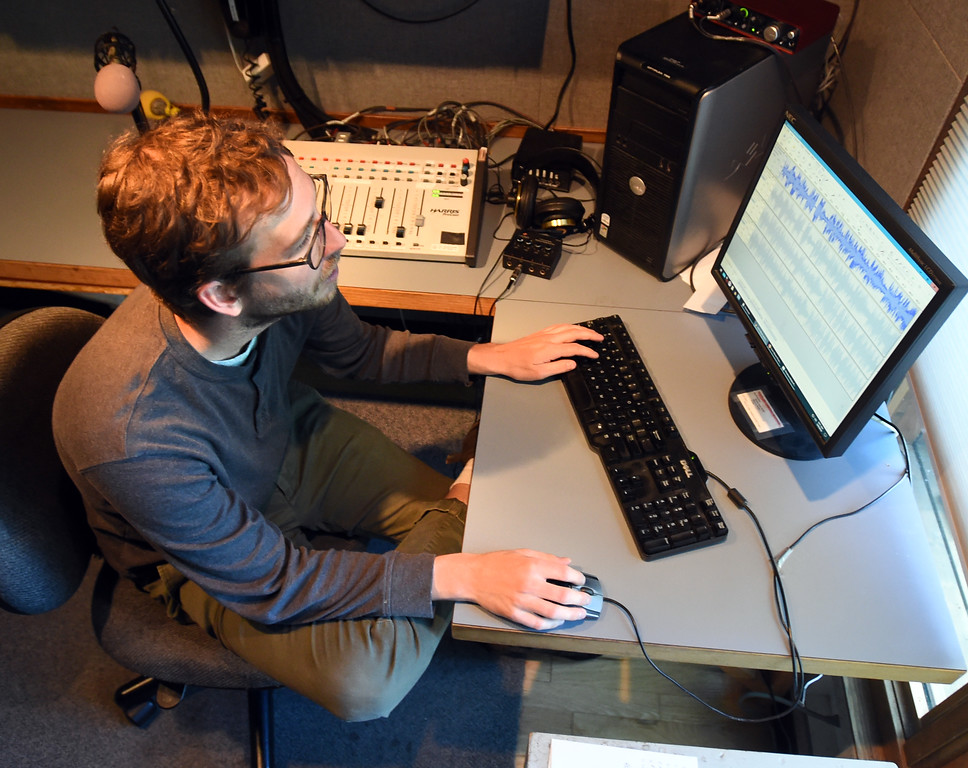 . Sean Maku, Promotions Director, works on a project on Wednesday. Boulder\'s KGNU community radio station is turning 40 this year and is hosting some events throughout the year to commemorate. For more photos, go to dailycamera.com. Cliff Grassmick  Photographer  May 9,  2018
