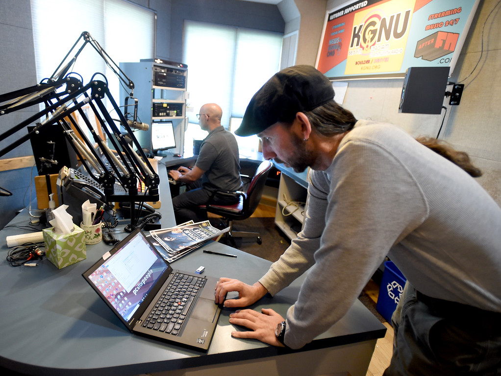 . Jon Walton, left, and Tim Russo, Station Manager,  work on a project on Wednesday. Boulder\'s KGNU community radio station is turning 40 this year and is hosting some events throughout the year to commemorate. For more photos, go to dailycamera.com. Cliff Grassmick  Photographer  May 9,  2018