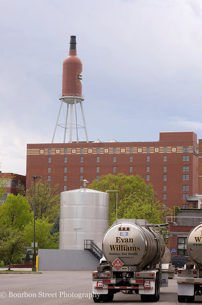 The Old Forester water tower above the Brown Forman Distillery as seen from the parking lot of the Heaven Hill Bernheim Distillery