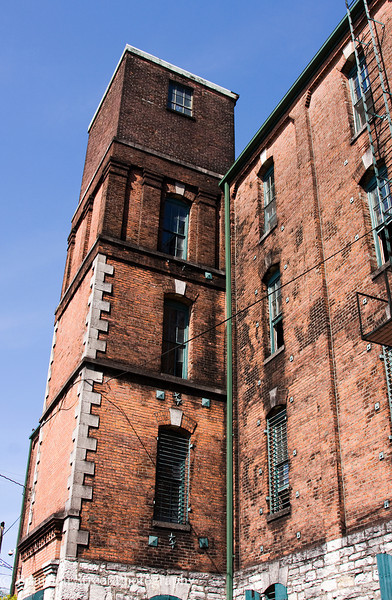 Barrel warehouse C. This warehouse is masonry, incorporating both local limestone and brick.