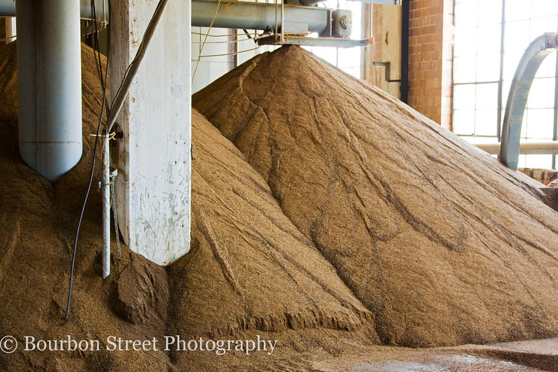Dried distiller's grain.  After the fermented mash (or distiller's beer) is distilled, the remaining solid grains and liquid are sold to farmers as high quality cattle feed.  Some distilleries sell to local farmers who fill up tanker trucks with the liquid product.  It can also be dried as shown here for easier transport.  This grain is highly nutritious aromatic and often shows up in local baking recipes.